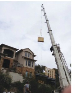 A Crane lifts the giant screen into the home.