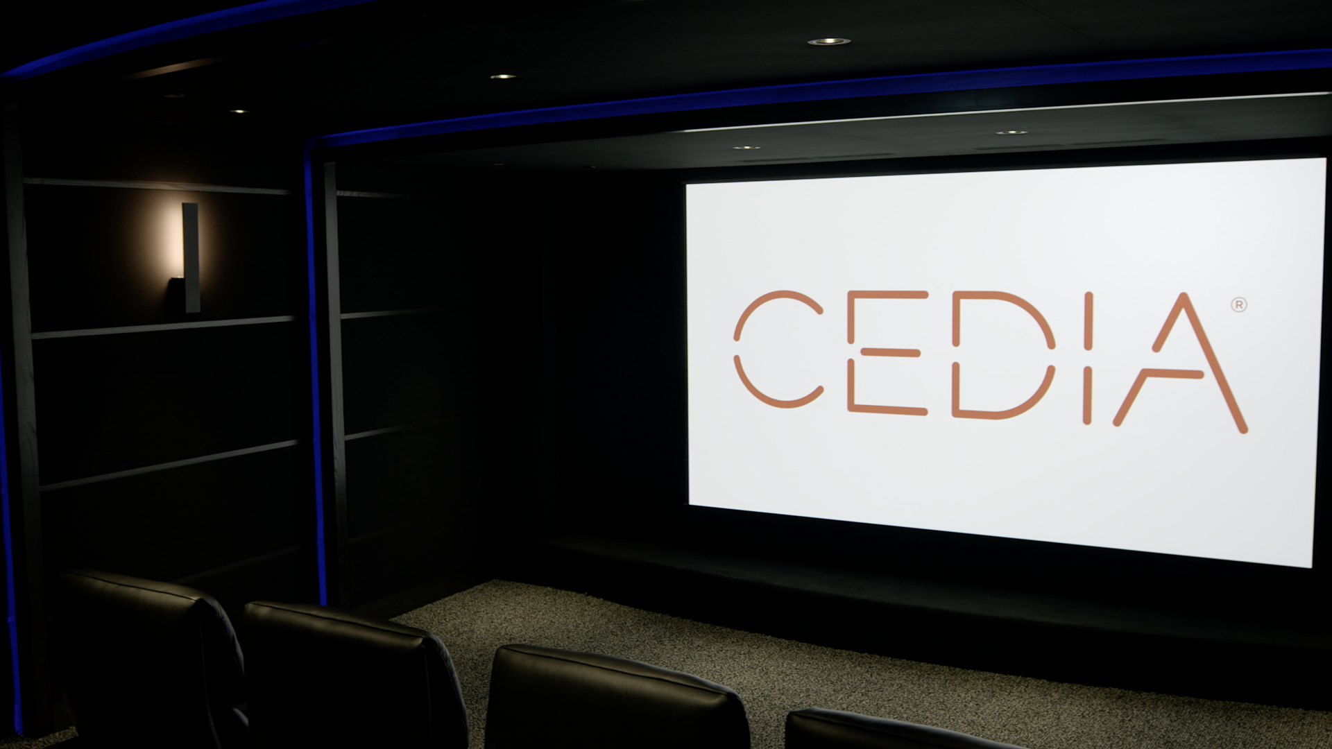 CEDIA on screen looking from right to left side of theater